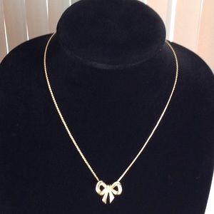 Vintage Avon Gold Tone Bow Pendant